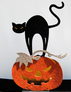 Isis The Black Cat Sitting On Top Of a Jack-O-Lantern, Lights up!